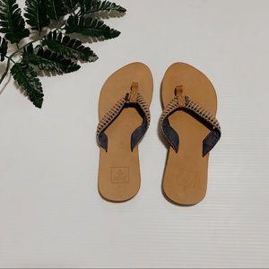 Reef light tan flip flops